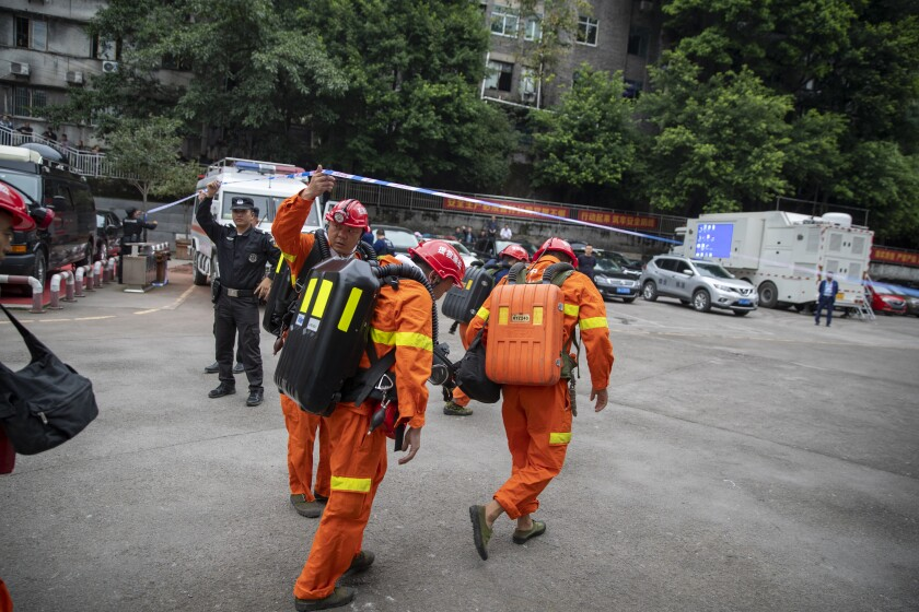Rescuers arrive at a coal mine in Chongqing, China, on Sunday.
