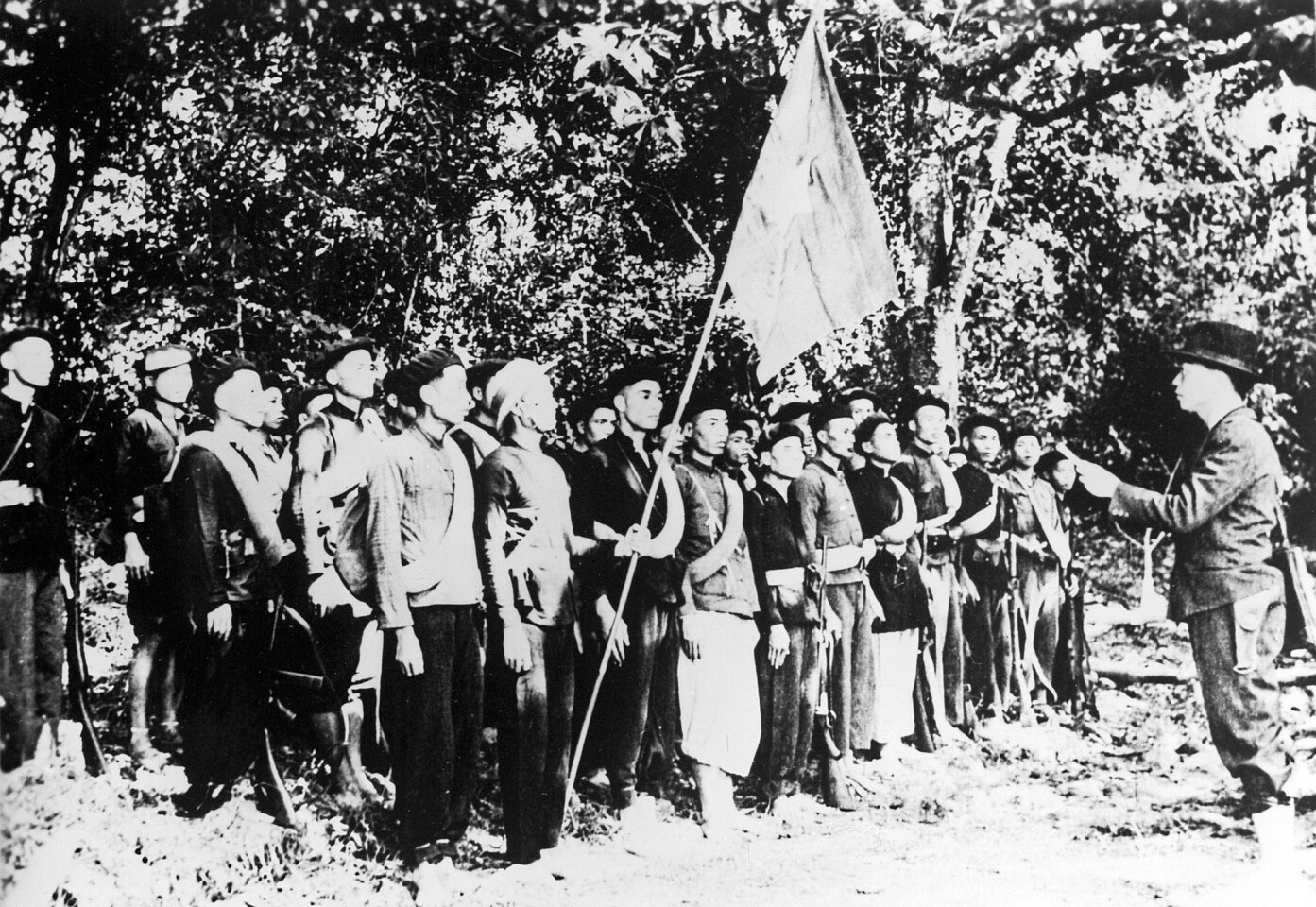 Gen. Vo Nguyen Giap, right, reads the first military order to the Vietnam Liberation Propaganda Army in Cao Bang province, Vietnam, in 1944.
