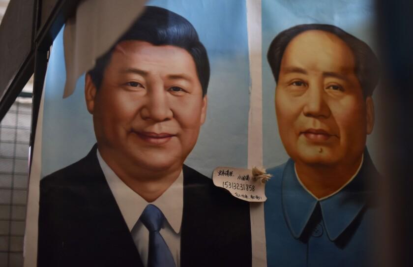 Portraits of Xi Jinping and Mao Zedong