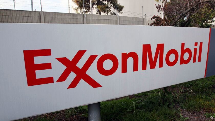The oil giant's request is being reviewed by the Trump administration and is certain to draw extra scrutiny because it involves a company formerly run by Secretary of State Rex Tillerson.