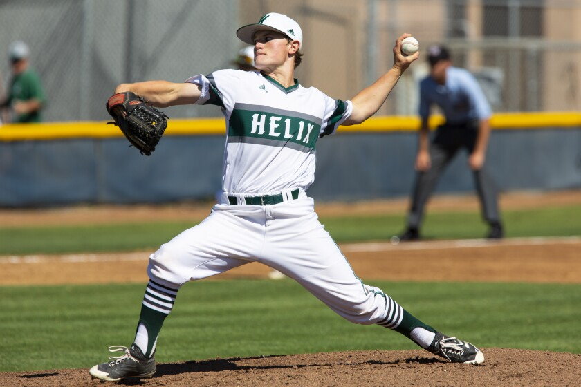 Helix pitcher Eric Smelko throws during the first inning against Eastlake.