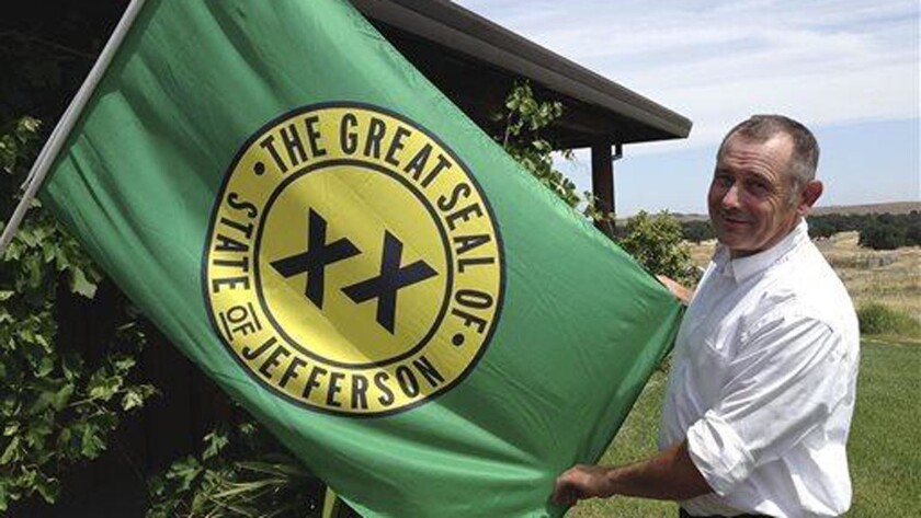 Tom Knorr, chairman of a 2014 secession campaign in Tehama County, holds the State of Jefferson flag with a logo that dates to the 1940s. There have been more than 200 secession efforts in California's history.