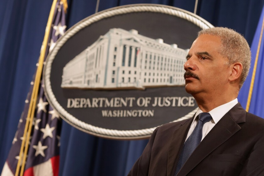The Justice Department announced a tightening of rules for when federal prosecutors can subpoena journalists or their records. Above, Atty. Gen. Eric Holder at a news conference last May.