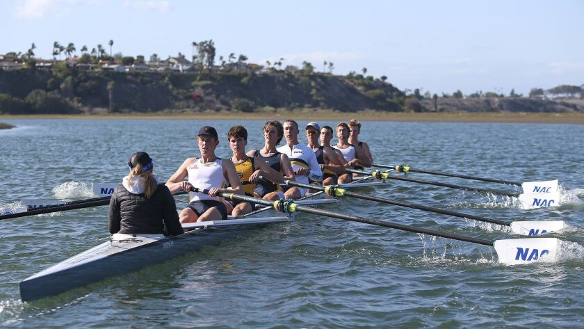 The Newport Aquatic Center's boys' Newport Harbor varsity 8 boat, pulls through the Back Bay during