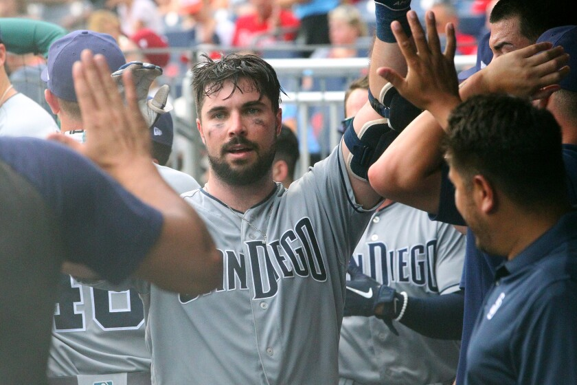 Austin Hedges is congratulated after his home run in the seventh inning gave the Padres a 3-2 lead over the Phillies on Sunday.