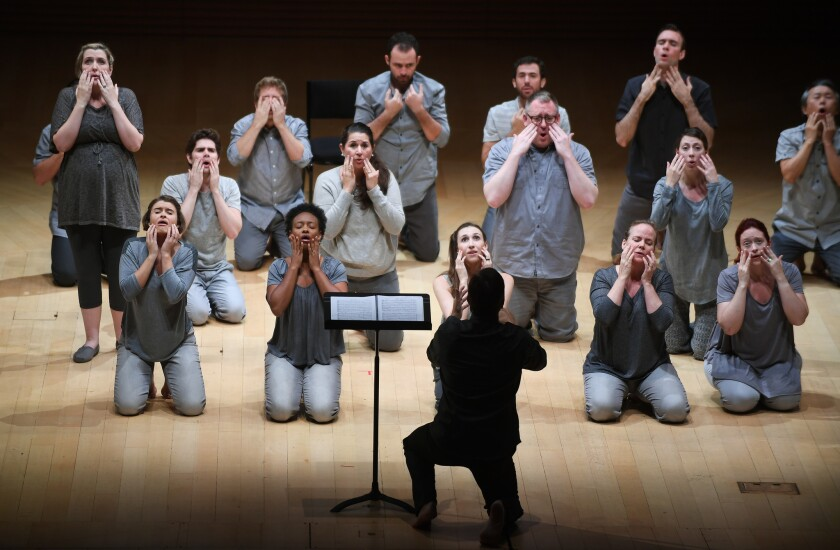 """Members of Los Angeles Master Chorale kneel as though they were Noh players during a recent performance of Orlando di Lasso's """"Lagrime di San Pietro."""""""