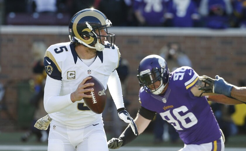 St. Louis Rams quarterback Nick Foles (5) is pressured by Minnesota Vikings defensive end Brian Robison (96) during the first half of an NFL football game, Sunday, Nov. 8, 2015, in Minneapolis. (AP Photo/Ann Heisenfelt)