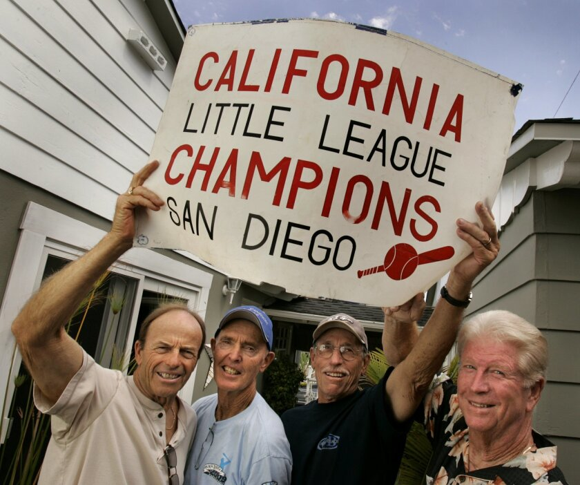 From left, Bill Harvey, Hugh McMillan, Bobby Mendoza and Ernie Miller say they felt like little kids again as they watched a television broadcast of Chula Vista's Park View Little League winning the world championship.