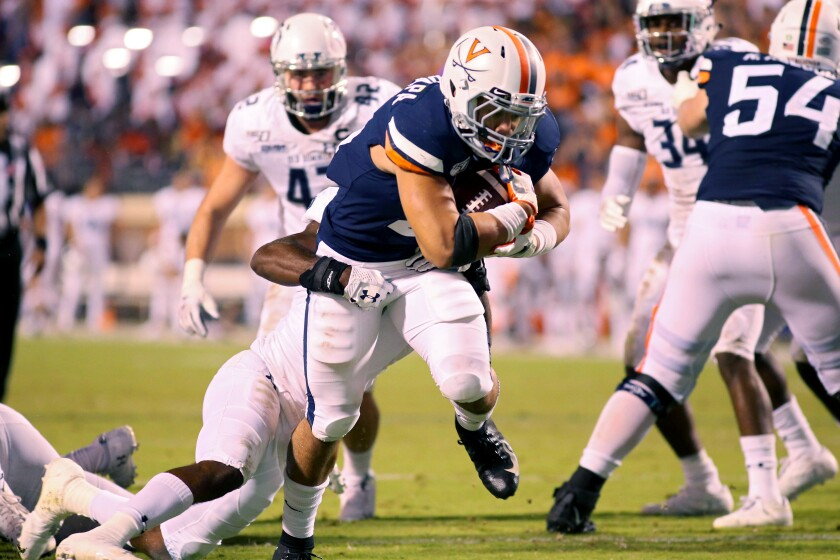 Virginia's Wayne Taulapapa rushes for a touchdown in the second half against Old Dominion on Saturday in Charlottesville, Va.
