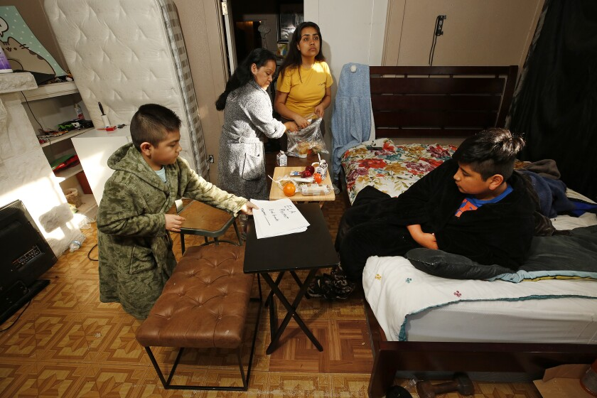 Raquel Lezama at home with her children. Her family struggles for its financial survival during the coronavirus pandemic.