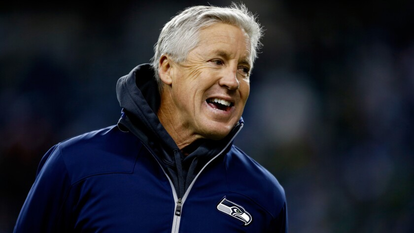 Seattle Seahawks Coach Pete Carroll smiles before a game against the New Orleans Saints in December. Carroll says he had no knowledge that NCAA sanctions were about to be imposed on USC when he left the university's football program.