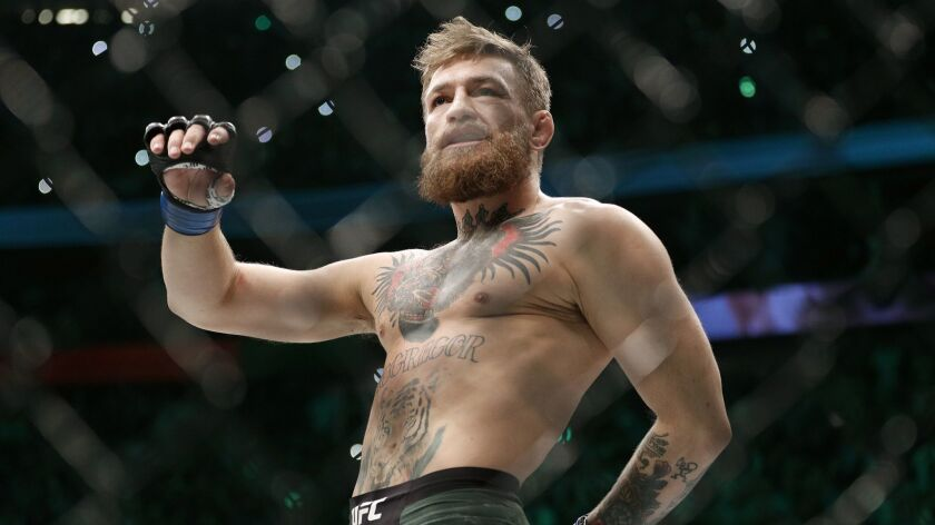 Conor McGregor walks in the cage before his fight with Khabib Nurmagomedov at UFC 229 in October.