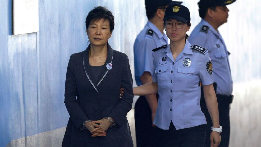 Former South Korean President Park Geun-hye is shown on her way to a court appearance in August 2017. She refused to participate in a yearlong trial.