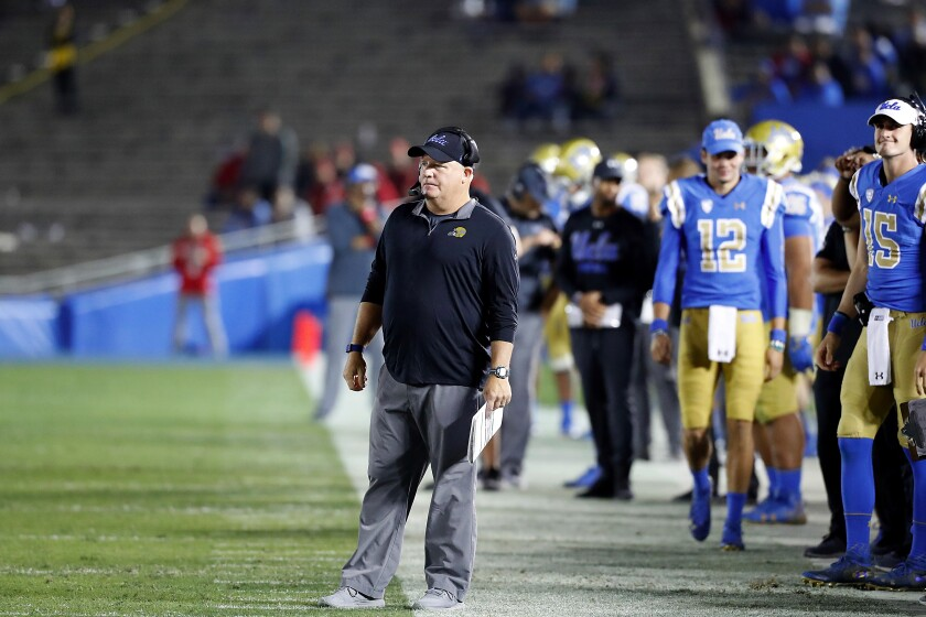 UCLA coach Chip Kelly watches the Bruins lose to Utah in a largely empty Rose Bowl last season.