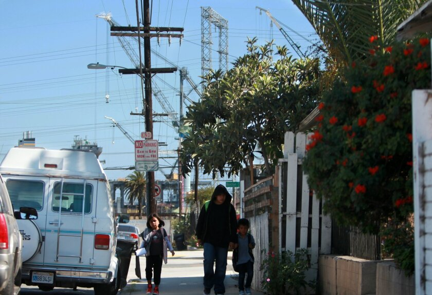In the Barrio Logan area, the mix between residential homes and industrial business is evident. This neighborhood and a few others would host license plate readers under a controversial proposal to track vehicle emissions.