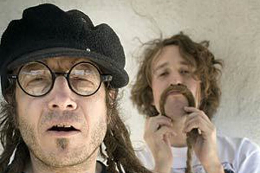 Keith Morris of Flag and FYF Fest's Sean Carlson. A judge has ruled in favor of Morris' new outfit Flag, in a trademark infringement lawsuit brought by Morris' former Black Flag bandmate Greg Ginn.