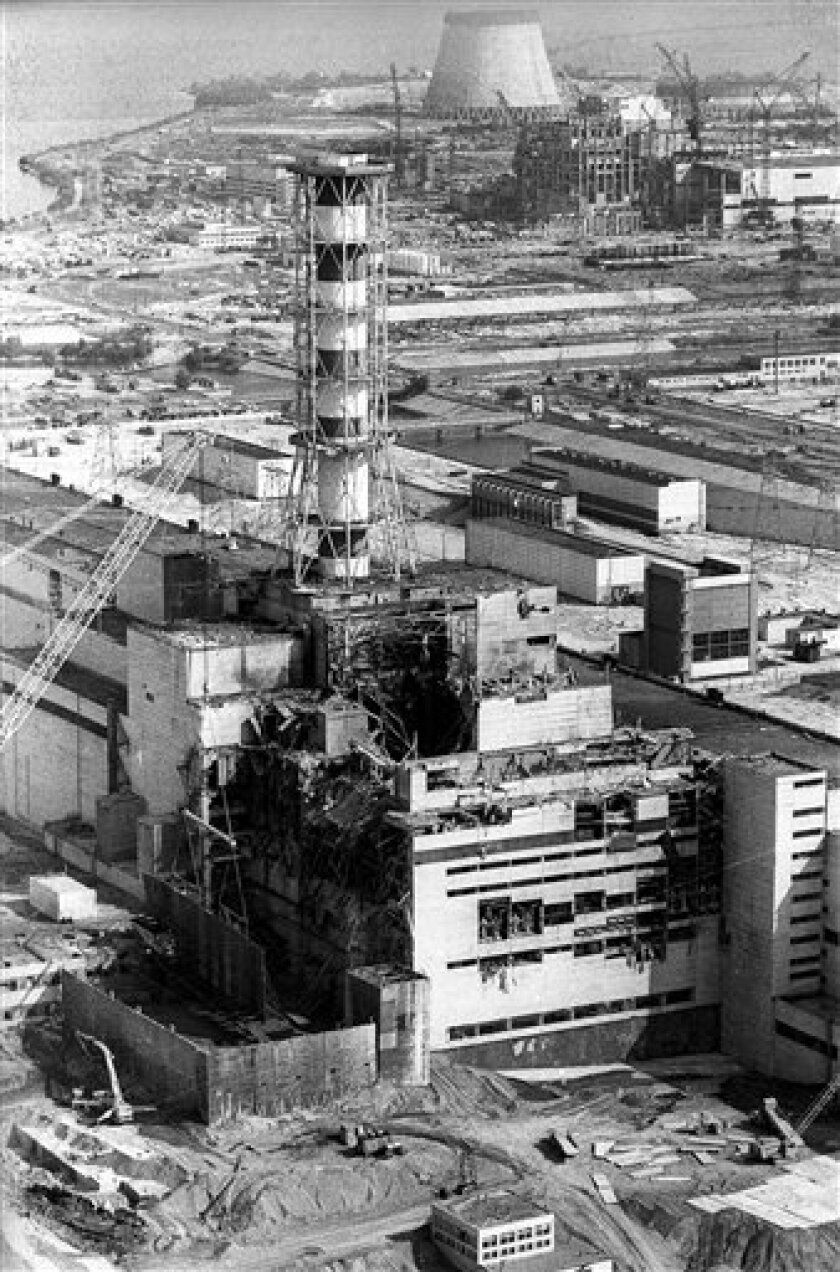 In this 1986 photo shows the sarcophagus under construction over the 4th destroyed reactor at the Chernobyl nuclear power plant. On May 12, 1986, more than two weeks after the explosion, the leading Soviet daily newspaper Pravda published its first photograph from the site for the first time, shot