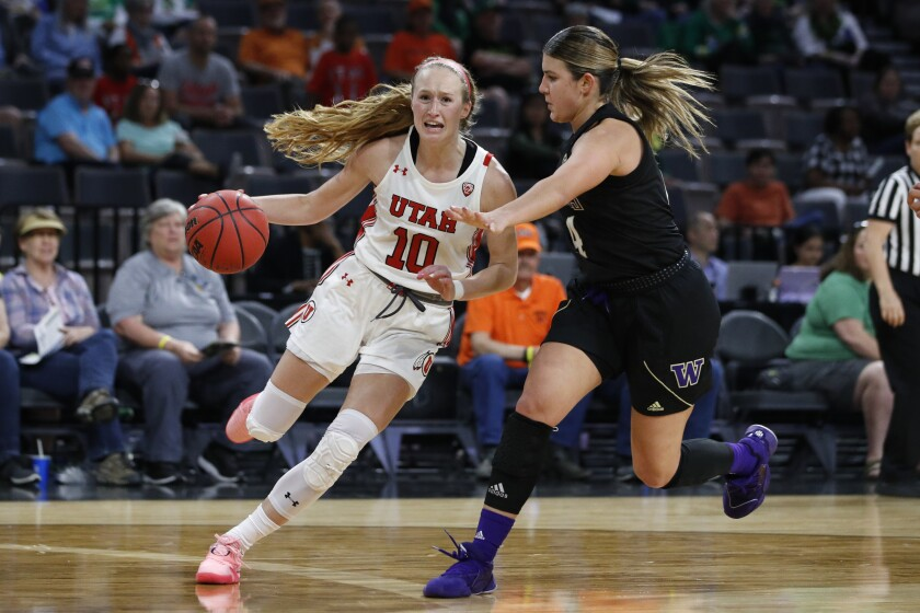 Utah's Dru Gylten (10) drives around Washington's Amber Melgoza during the second half of an NCAA college basketball game in the first round of the Pac-12 women's tournament Thursday, March 5, 2020, in Las Vegas. (AP Photo/John Locher)