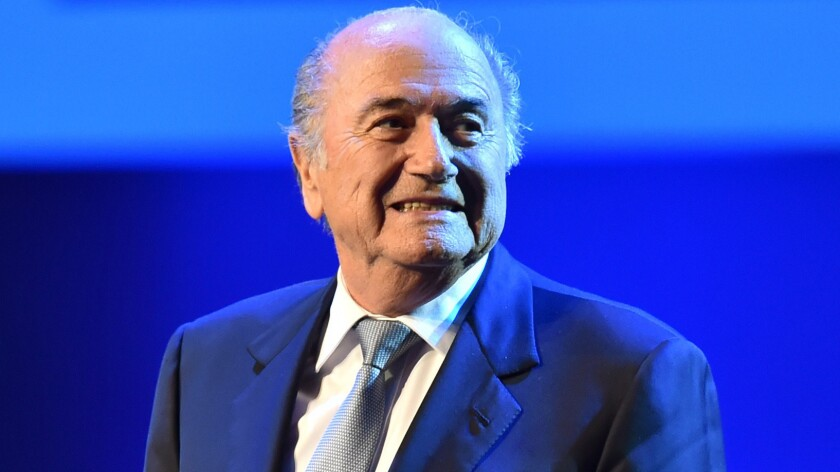 FIFA President Sepp Blatter stands on stage during the opening ceremony of the FIFA Congress in Sao Paulo, Brazil, on Tuesday. Blatter doesn't seem bothered by the scandals he had faced during his tenure as president.