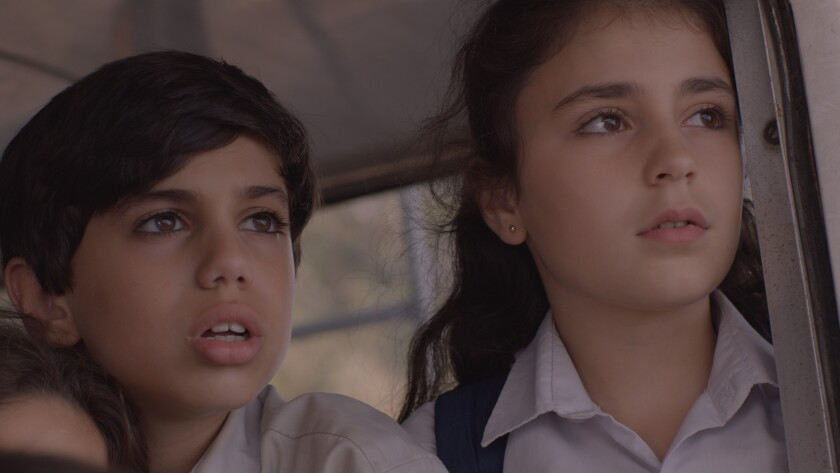 "Mohamad Dalli as Wissam and Gia Madi as Joana in ""1982."""