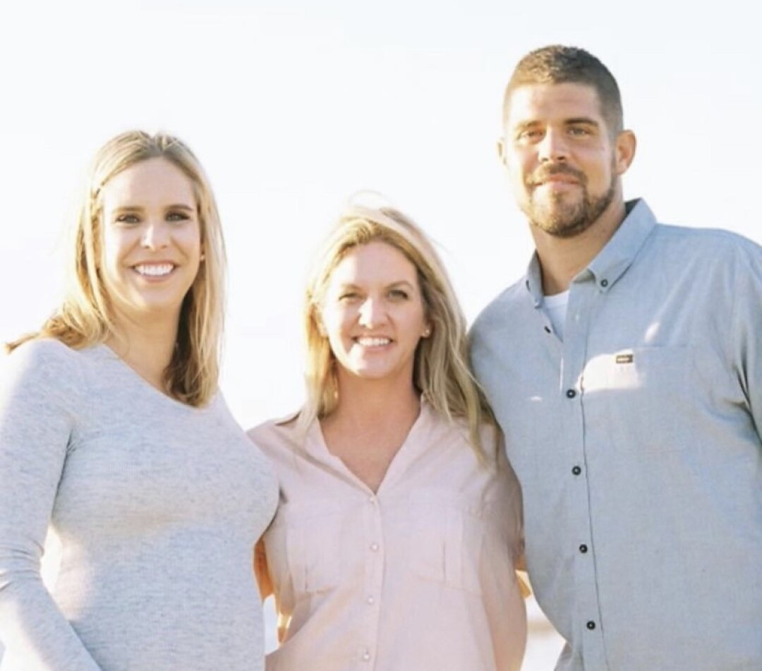 Colt Brennan in an undated family photo with sisters Chanel, left, and Carrera.