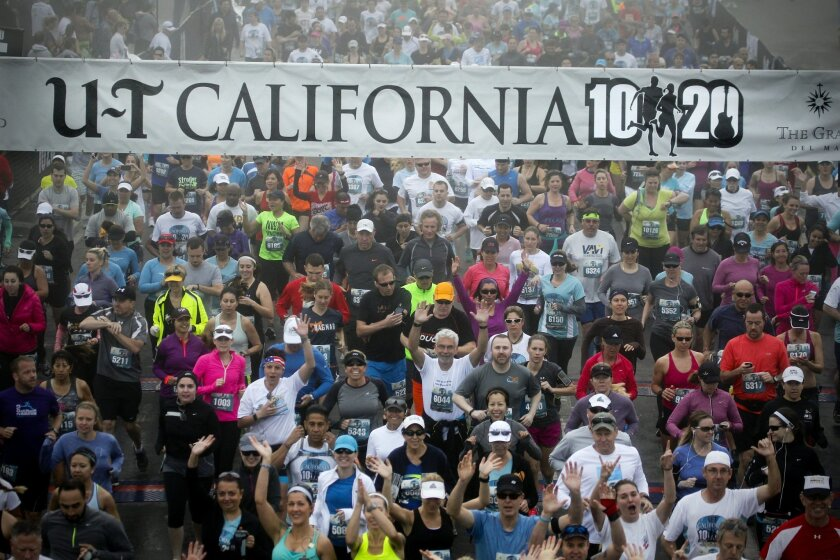 Runners begin the U-T California 10/20 race,  which began and ended at the Del Mar Fairgrounds.