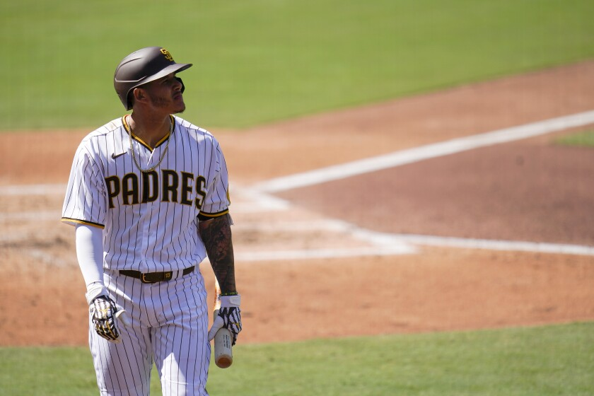 San Diego Padres' Manny Machado looks on after striking out.