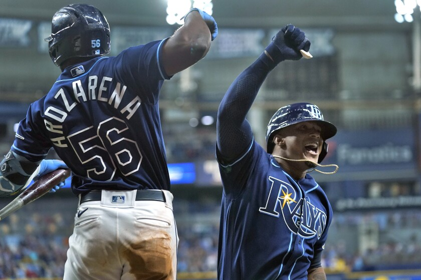 Tampa Bay Rays' Wander Franco celebrates his three-run home run off Boston Red Sox starting pitcher Eduardo Rodriguez with Randy Arozarena (56) during the fifth inning of a baseball game Tuesday, June 22, 2021, in St. Petersburg, Fla. (AP Photo/Chris O'Meara)