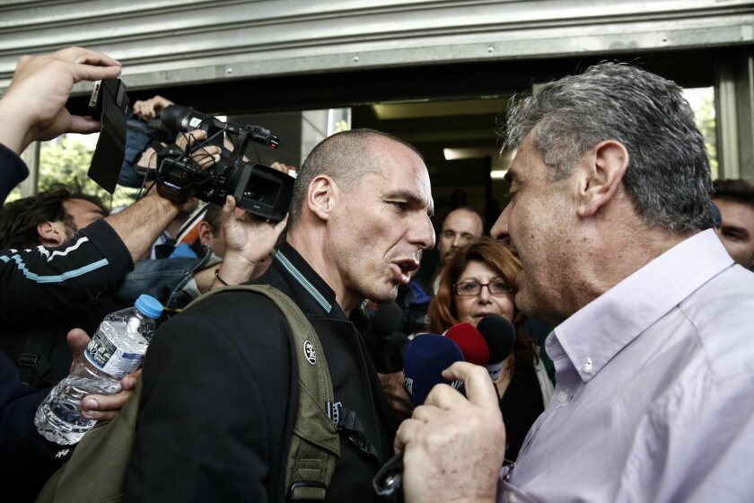 Greece's Finance Minister Yanis Varoufakis talks with a unionist during a protest by tax office employees outside the Finance ministry in Athens, Greece, Thursday, April 30, 2015. Varoufakis has indicated his country's left-wing government could make concessions on key demands by bailout lenders over the summer after a deal is reached to unlock remaining rescue funds. (AP Photo/Yorgos Karahalis)
