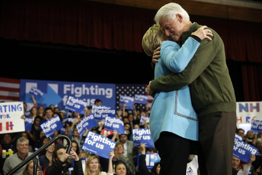 Democratic presidential candidate Hillary Clinton and former President Bill Clinton embrace during a campaign stop Monday, Feb. 8, 2016, in Hudson, N.H. (AP Photo/Matt Rourke)