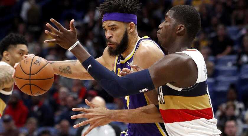Los Angeles Lakers center JaVale McGee (7) is defended by New Orleans Pelicans forward Cheick Diallo