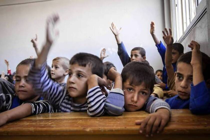 Syrian schools start new year, a return to some normality for kids