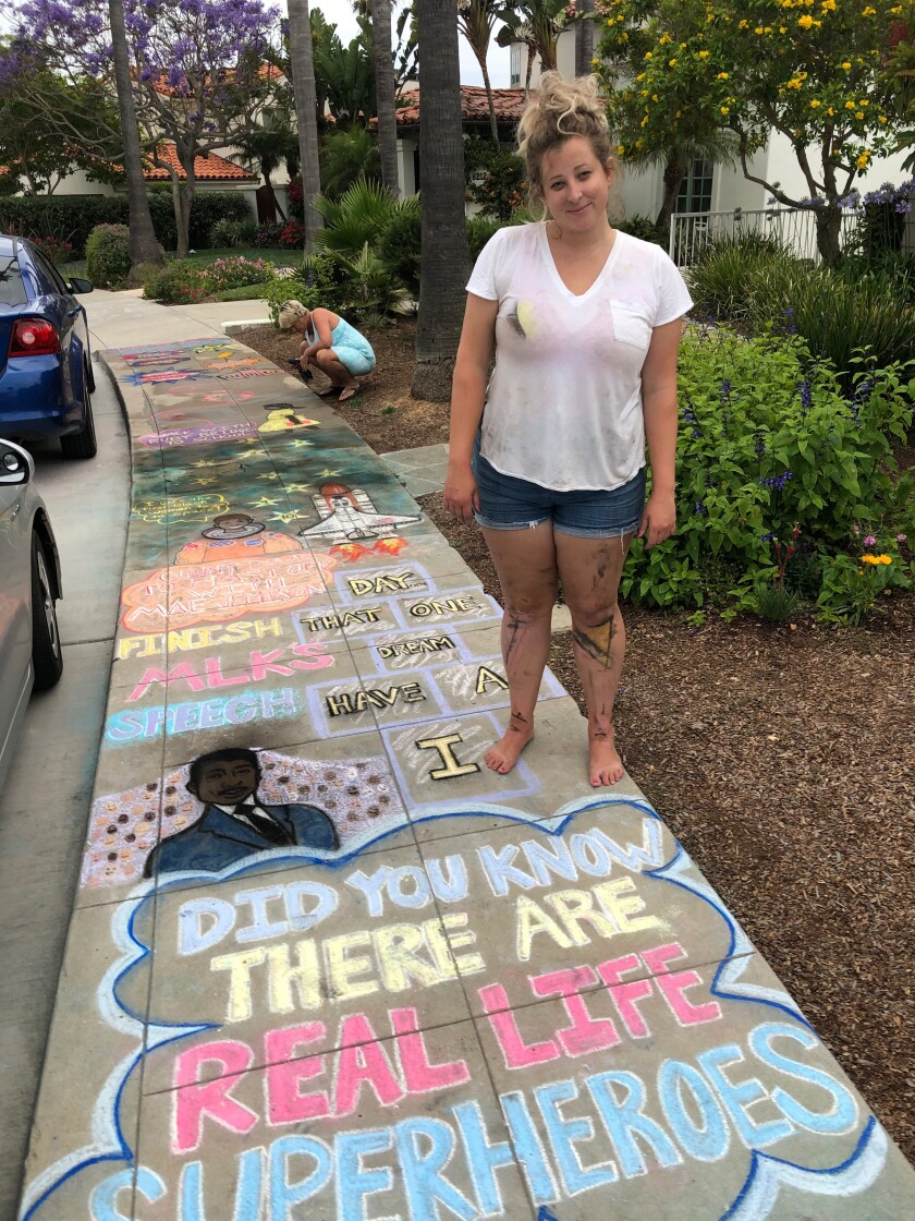 "Amelia Leidy shows a recent sidewalk chalk ""sensory path"" she drew in the Upper Hermosa area of La Jolla."