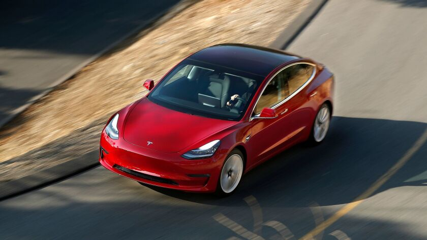 Tesla's new Model 3, shown here on a test drive in Los Angeles earlier this month, has received more than 450,000 pre-orders from potential customers.