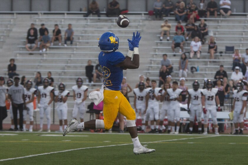 Fountain Valley High receiver Kishaun Sykes catches the ball and scores a touchdown against Troy at Cap Sheue Field on Aug. 16, 2018.