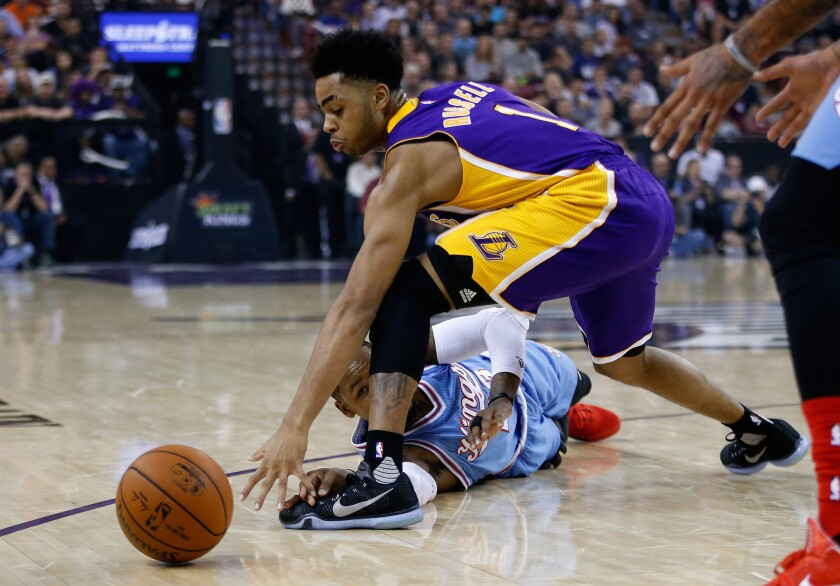 Sacramento Kings' Ben McLemore and Lakers' D'Angelo Russell go for the loose ball at Sleep Train Arena on Friday.