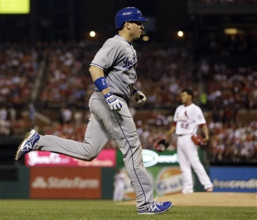 Los Angeles Dodgers' A.J. Ellis, left, rounds the bases after hitting a three-run home run off St. Louis Cardinals starting pitcher Carlos Martinez, rear, during the fifth inning of a baseball game on Thursday, Aug. 8, 2013, in St. Louis. (AP Photo/Jeff Roberson)
