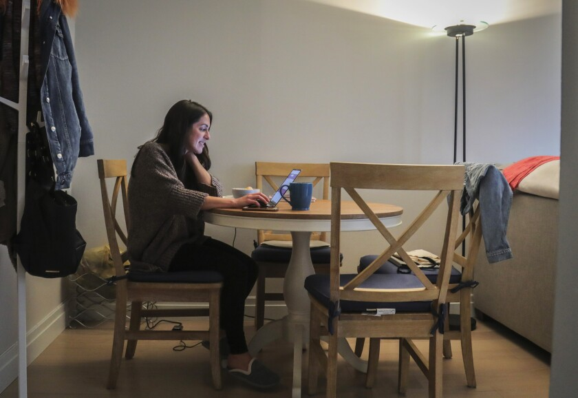 Lindsay Garfield, finance director at SquareFoot, which helps companies find office space, works from home in New York earlier in March.