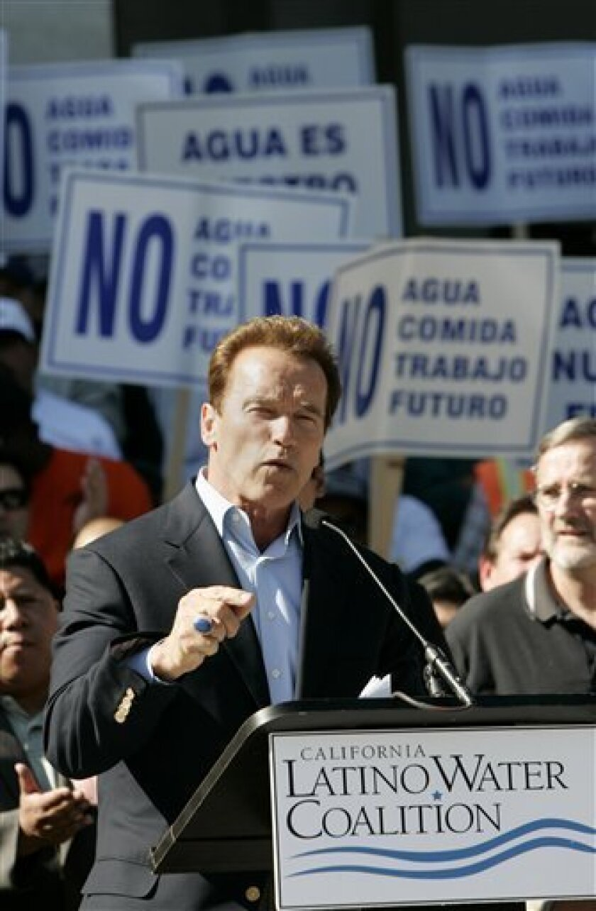 Gov. Arnold Schwarzenegger speaks before a crowd of farm workers and members of a Hispanic water coalition outside the Capitol in Sacramento., Calif., on Oct. 9, 2009. (AP Photo/Rich Pedroncelli, File)