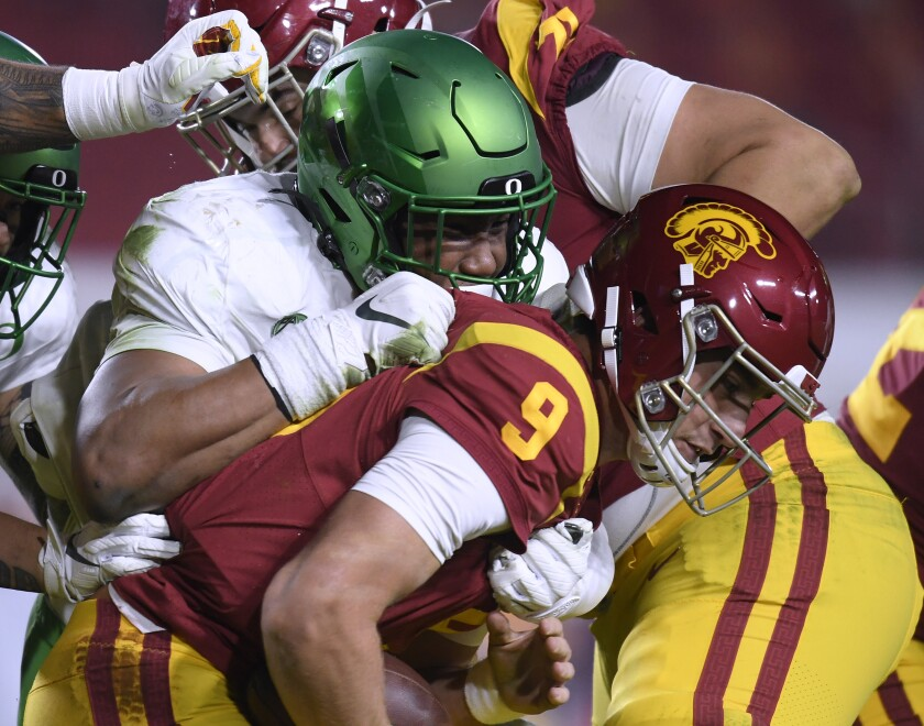 USC's Kedon Slovis is sacked by Oregon's Brandon Dorlus during the Pac-12 title game Dec. 18, 2020, in Los Angeles.