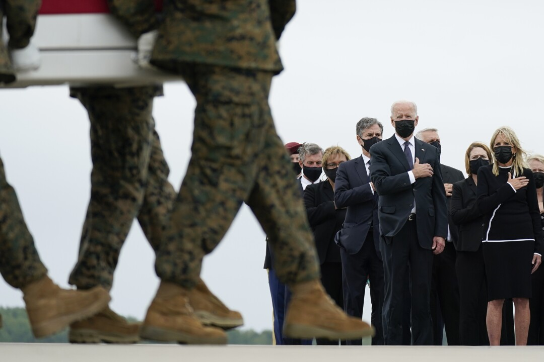 President and Jill Biden watch as the remains of Lance Cpl. Kareem M. Nikoui are transferred