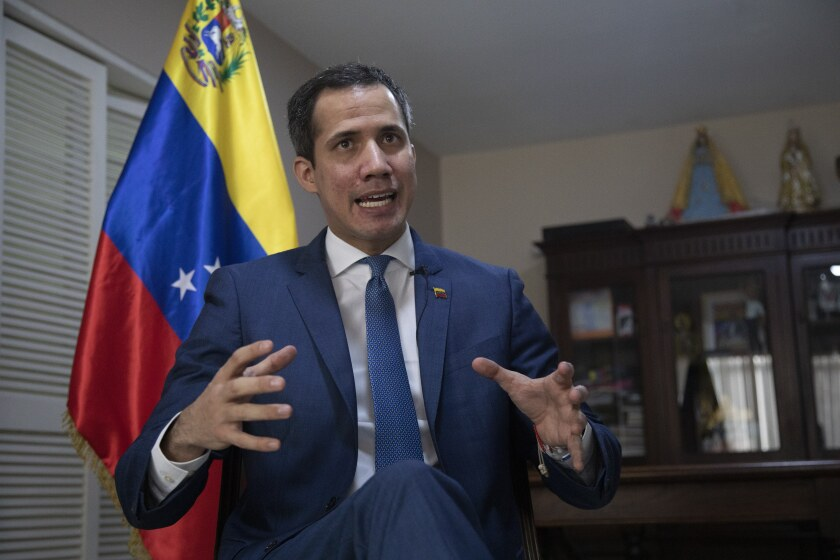 Venezuelan opposition leader Juan Guaidó speaks during an interview with The Associated Press, in Caracas, Venezuela, Wednesday, Dec. 9, 2020. Guaidó launched a risky referendum on Monday, betting some of their prestige on hopes they hope can reignite a campaign to oust President Nicolas Maduro in a nation suffering unprecedented economic and political crises that have spurred millions to flee abroad. (AP Photo/Ariana Cubillos)