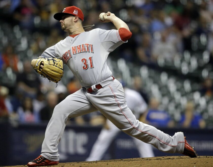 Cincinnati Reds starting pitcher Brandon Finnegan throws to the Milwaukee Brewers during the first inning of a baseball game Friday, Sept. 18, 2015, in Milwaukee. (AP Photo/Jeffrey Phelps)