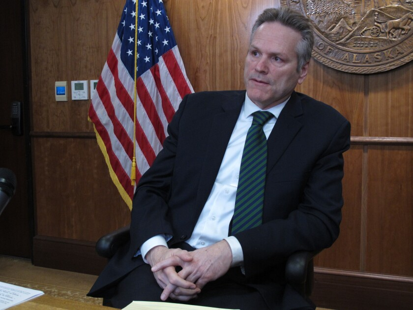 In this Jan. 31, 2020 photo, Alaska Gov. Mike Dunleavy speaks to reporters in Juneau, Alaska. On Wednesday, Feb. 12, Dunleavy proposed a state lottery as a way to provide a new source of revenue. (AP Photo/Becky Bohrer)