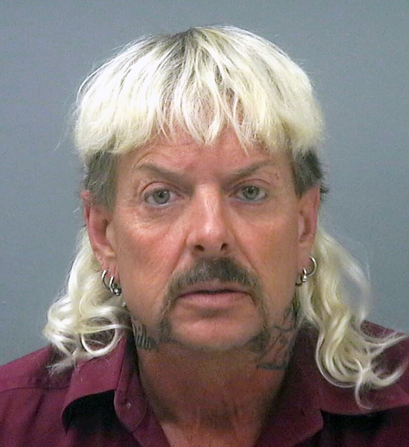 """FILE - This undated file photo provided by the Santa Rose County Jail in Milton, Fla., shows Joseph Maldonado-Passage, also known as Joe Exotic. The former Oklahoma zookeeper sentenced to 22 years in prison for his role in a murder-for-hire plot and violating federal wildlife laws is formally requesting a pardon. Attorneys for Maldonado-Passage, filed his application Tuesday, Sept. 8, 2020, with the U.S. Department of Justice. In it, Maldonado-Passage maintains his innocence and requests a pardon """"to correct the injustices he has experienced."""" (Santa Rosa County Jail via AP, File)"""