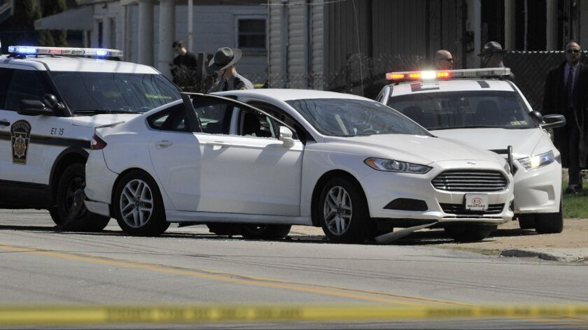 Pennsylvania State Police investigate the scene where Steve Stephens, a suspect in the random killing of a Cleveland retiree, was found dead in Erie. Pa.