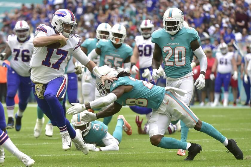 Bills quarterback Josh Allen scrambles during a game Nov. 17 against the Dolphins at Hard Rock Stadium.