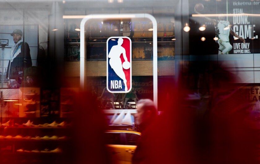 An NBA logo is displayed in a store in New York City.