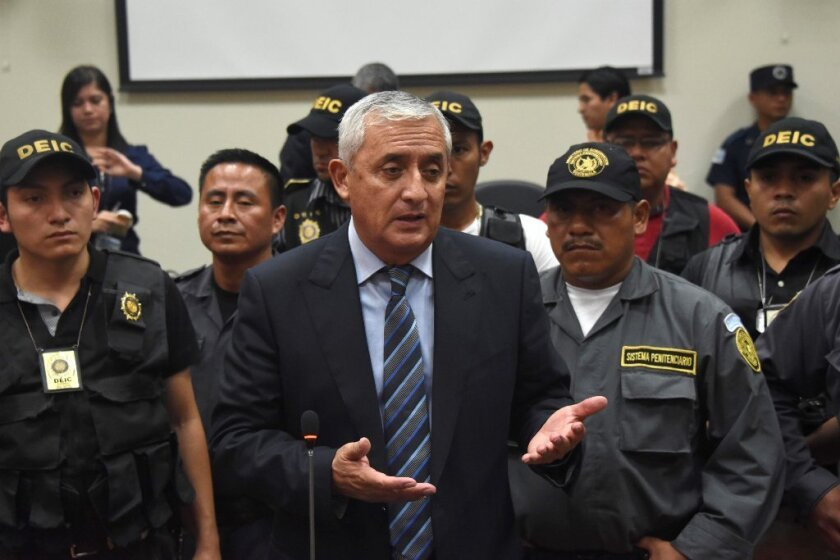 Former Guatemalan President Otto Perez Molina speaks with journalists at the end of a hearing at the Supreme Court in Guatemala City on Friday.