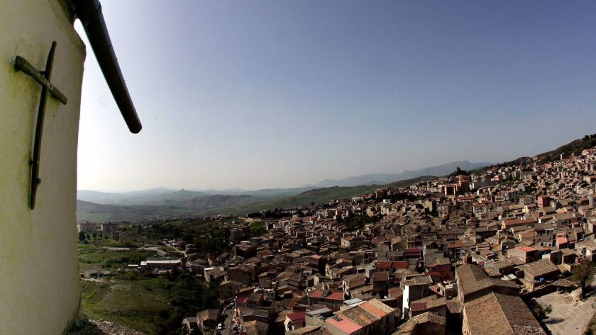 FILE - In this April 24, 2006 file photo a crucifix towers over the Sicilian town of Corleone, south